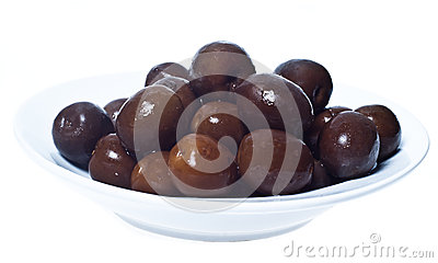 Brown  olives in bowl isolated
