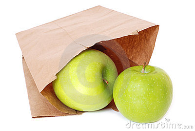 Brown paper bag with green apples