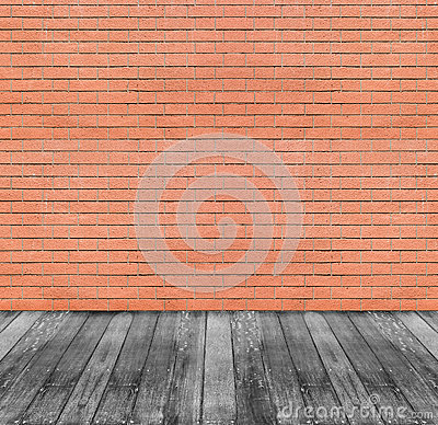 Brown red brick wall and black wooden floor