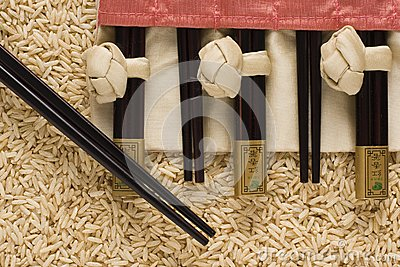 Brown rice and chopsticks in s