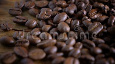 Brown roasted coffee beans. Close up stock video footage