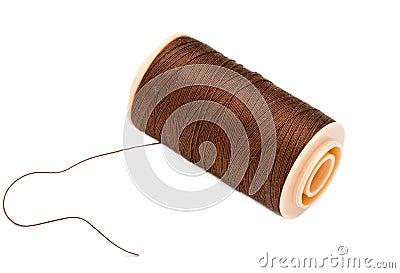 Brown  Silk Cotton Thread On Plastic Reel.