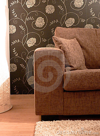 Brown Sofa and Flower Wall Paper
