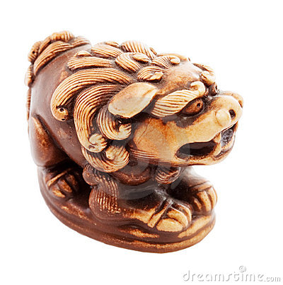 Brown statuette of dog