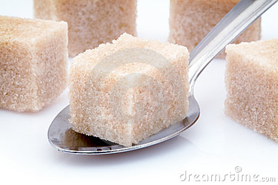 Brown sugar cube and spoon