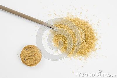 Brown sugar on silver teaspoon