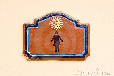 Brown tablet on women enter of toilet