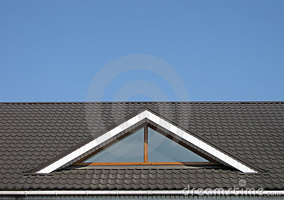Brown tile roof construction, blue sky,