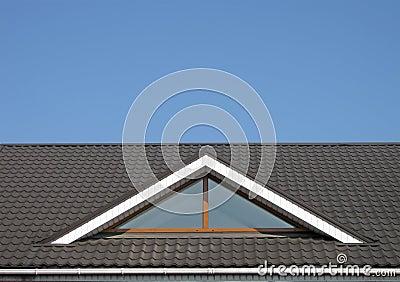 Brown tile roof construction, blue sky,
