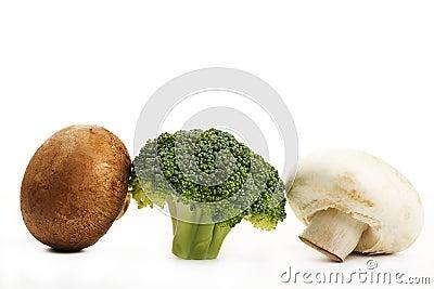 Brown, white mushroom and one broccoli