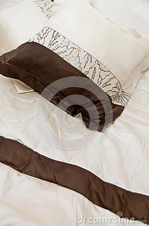 Brown and white bed linens