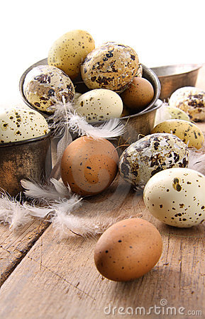Brown and white speckled eggs on table