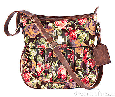 Brown women s purse with floral pattern on white