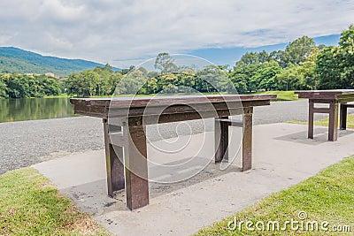 brown wooden bench at a green lake