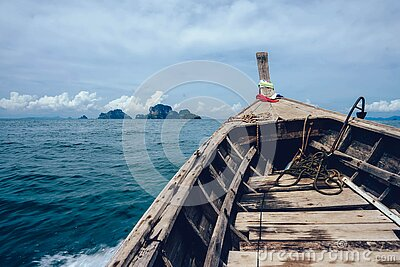 Brown Wooden Boat On Sea Overlooking Rocky Island Free Public Domain Cc0 Image