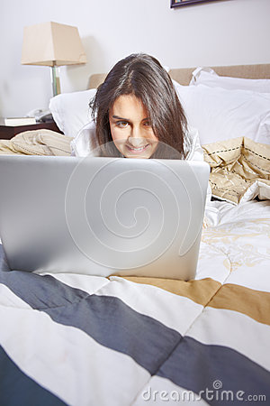Browsing internet on bed