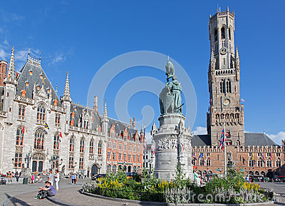 Bruges - The Carriage on the Grote Markt and Belfort van Brugge in background. Editorial Stock Photo