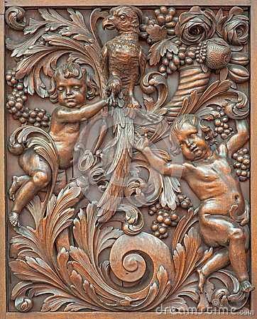 Bruges - The carved symbolic relief of angels with the bird in Karmelietenkerk (Carmelites church)
