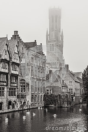 Bruges water canal and Belfry tower in monochrome