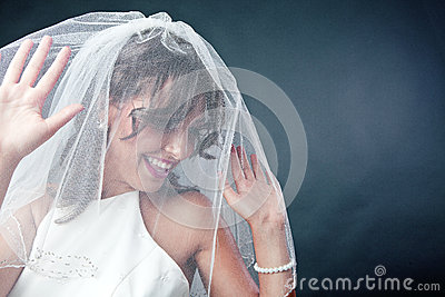 Bruid die bruidssluier draagt