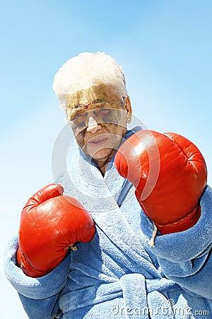 Bruised senior boxing woman