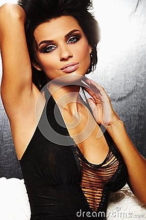 A brunet sexy girl on sofa