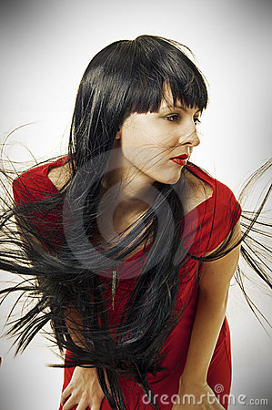 Brunet woman with long flying hair
