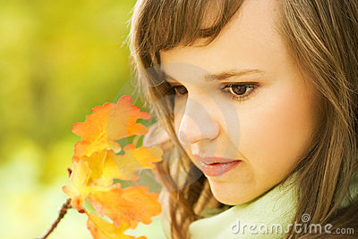 Brunette with autumn leaves