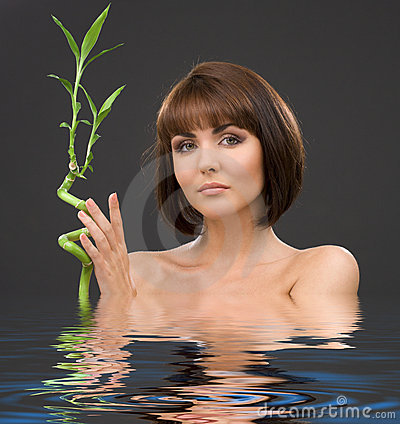 Brunette with bamboo