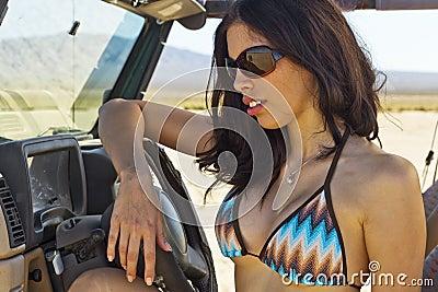 Brunette Bikini Model In Desert