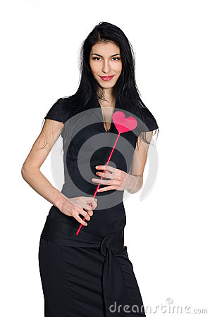 Brunette in black dress with  heart made of paper