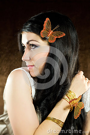 Brunette with brown-gold butterfly