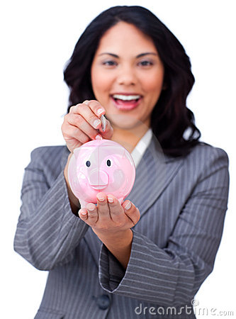 Brunette businesswoman saving money in a piggybank