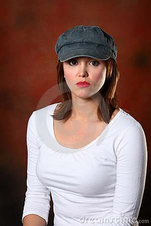 Brunette with cap red backdrop