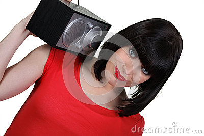 Brunette carrying radio