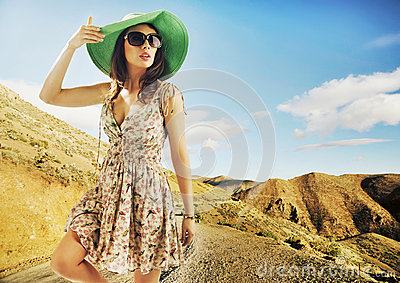 Brunette cutie with huge sunglasses and green hat Stock Photo