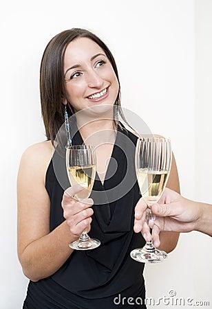 Brunette drinking champagne