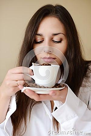 Brunette enjoying smell of coffee