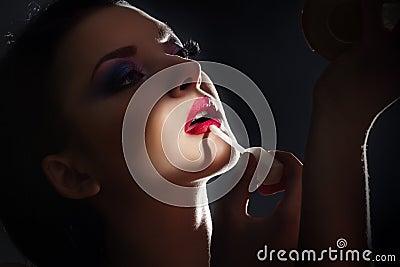 Brunette in front of mirror
