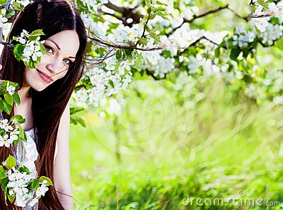 Brunette girl in blossom garden