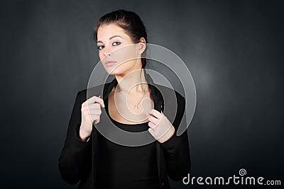 Brunette girl in coat, hold for coat