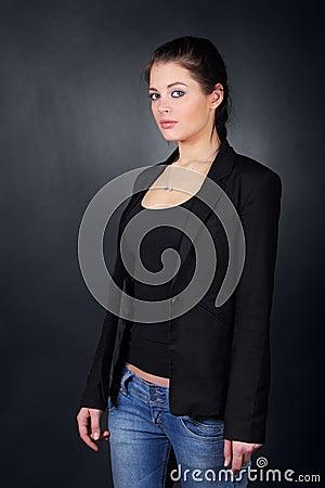 Brunette girl in coat stand