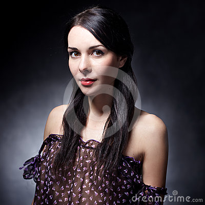 Brunette girl on dark background