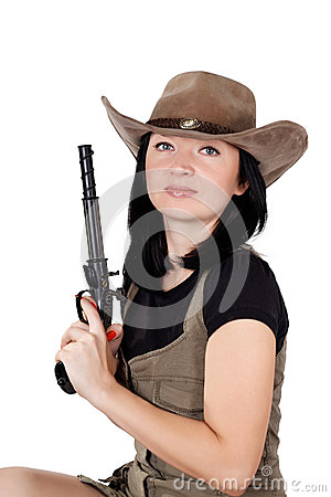 Brunette girl in a hat with a gun