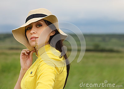 Brunette girl in hat in summer day