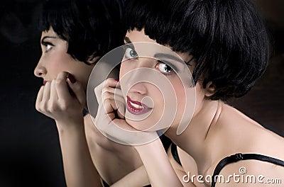 Brunette girl before a mirror
