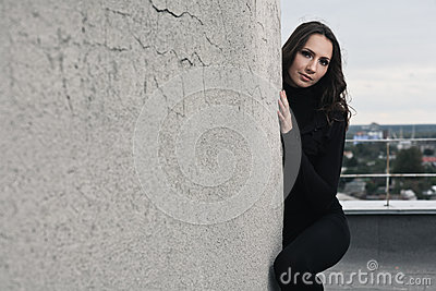 Brunette girl near wall