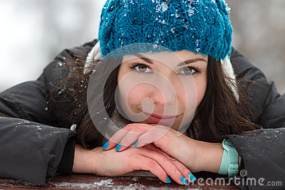 Brunette girl outdoors in winter