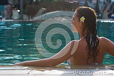 Brunette girl in the pool