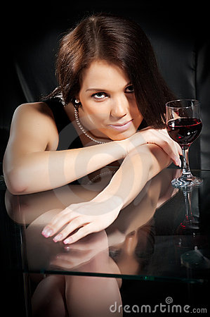 Brunette with a glass of wine